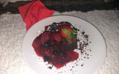 Olive oil chocolate brownies and a mixed berry sauce.